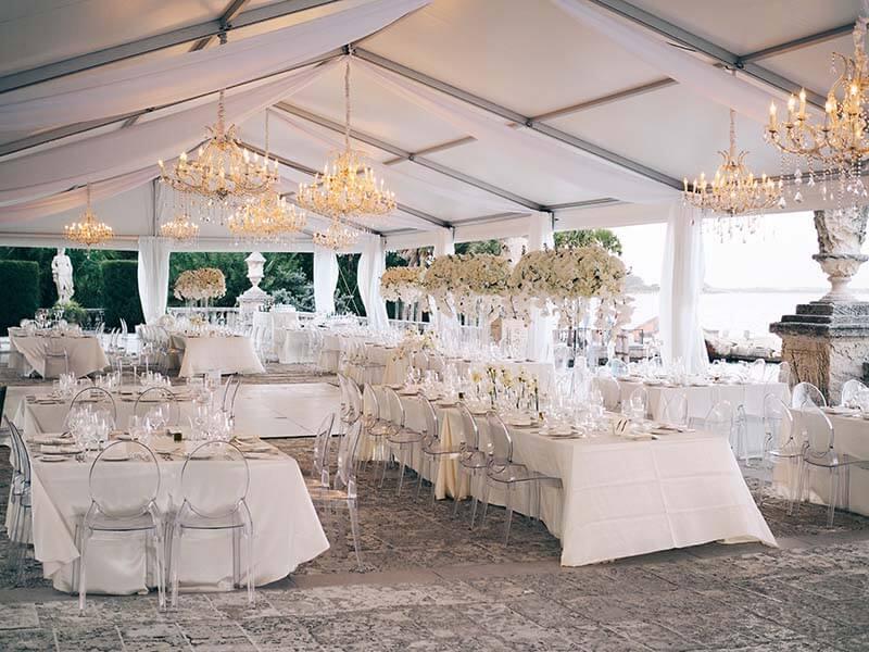 wedding reception venue outdoors under tent