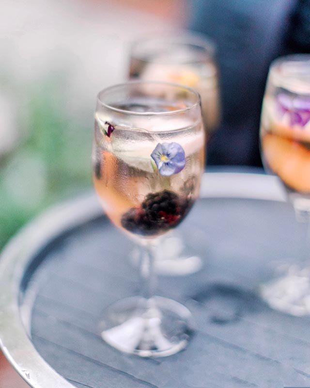 alcoholic beverage with berry and flower