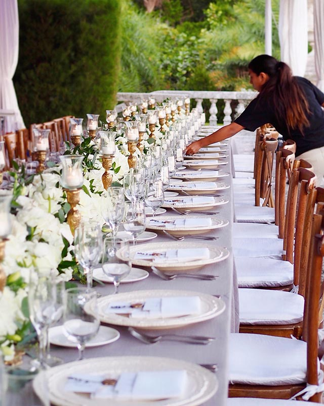 long table being set for event