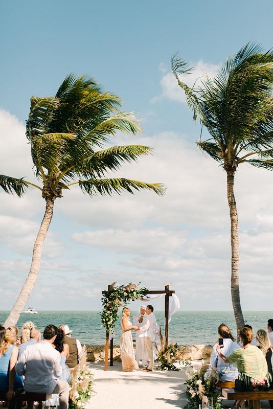 wedding being held by ocean