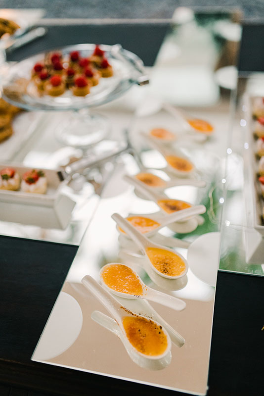 appetizers being served in large spoons