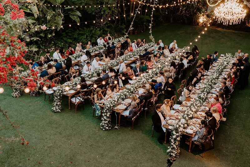 overlooking image of wedding reception guests seated and eating